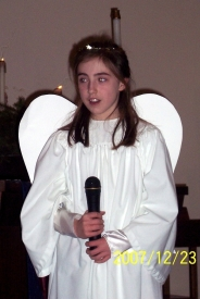 Fellow Off the Merry-Go-Round blogger Karen's daughter Kelly as the angel Gabriel