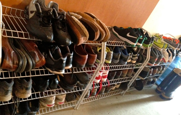 I purposefully included the winter boots in the photo as they will not fit on this rack.  We store our winter boots on a tray just beyond the racks in the winter and in our attic over the garage in the off-season.