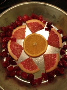 Orange, grapefruit and cranberries form a geometric design