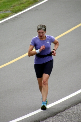 "Feeling it... as I approach the finish line of a mini-tri.  My ""no-frills"" watch helps me keep track of my time."