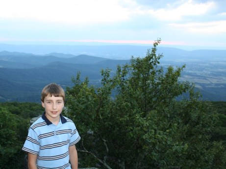 Here, my son is in the lower left-hand third of the photo with a mountain vista behind him.