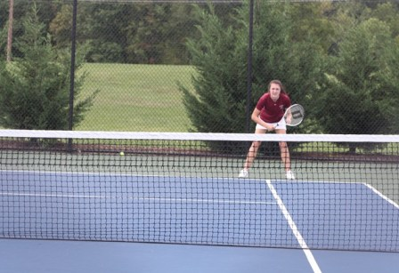 Instead of filling the entire shot with my daughter, I opted to place her in the upper right-hand third of the photo, exactly where she was placed on the tennis court.