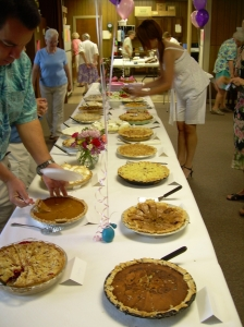 A table filled with lots of pies to sample!
