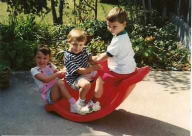 The first friends... our oldest children rock the teeter-totter in 1998
