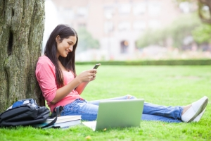 A-beautiful-hispanic-college-student-texting-on-her-cellphone