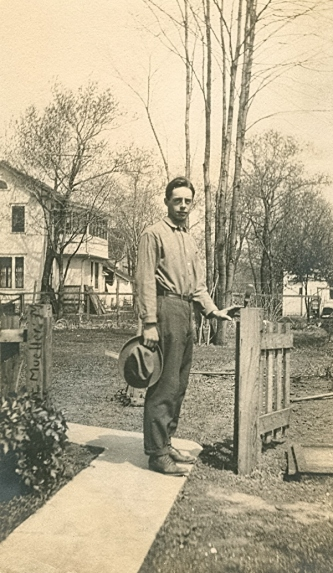 Paul 1910 in Mpls (hand on post)