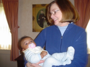 My mother's dear friend who became my aunt holds my son when he was a baby.