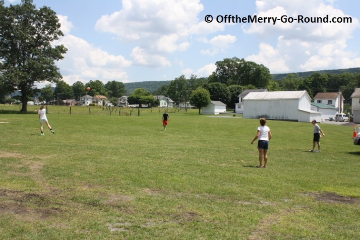 Something as simple as throwing around a football makes for a fun family reunion activity.